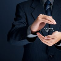 Protection of human rights concept. Lawyer (jurist) protect your rights with hand gesture.